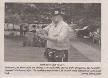 Illusionist Jim Macdonald busking at the Lancaster Farmers' Market.