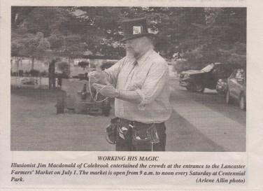 Illusionist Jim Macdonald busking at the Lancaster Farmers' Market.