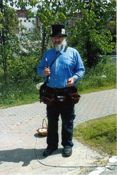 Jim Macdonald, Illusionist, busking at the Littleton, NH, Farmers' Market